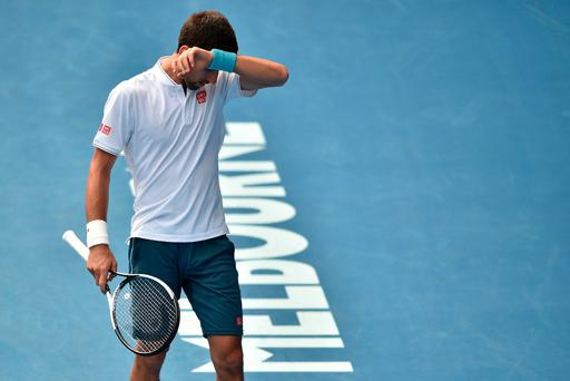 Down and out: Novak Djokovic reacts after his latest shock defeat, this time in the second round of the Australian Open