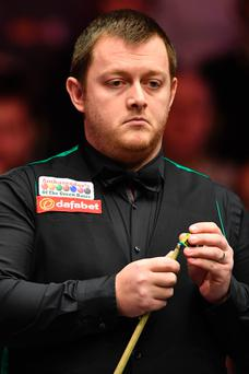 Exit: Mark Allen on the way to a 6-2 defeat to Marco Fu last night at Alexandra Palace