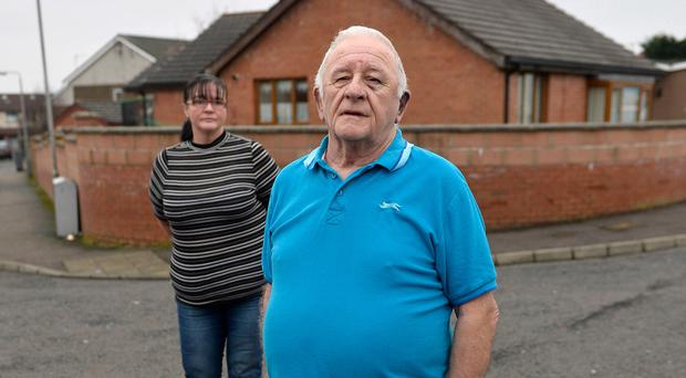 Charles Hill at his home in Blacks Road with daughter Nuala just yards from where he beaten up