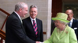 Martin McGuinness meeting the Queen with Peter Robinson