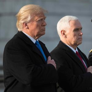 US President-elect Donald Trump and Vice President-elect Mike Pence take part in a wreath-laying ceremony at Arlington National Cemetery in Arlington, Virginia on January 19, 2017. / AFP PHOTO / Mandel NganMANDEL NGAN/AFP/Getty Images