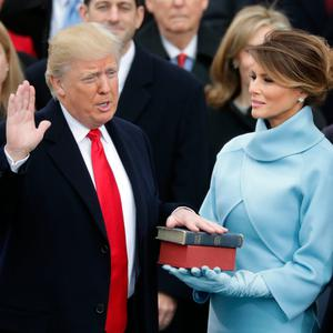 President Donald Trump takes the oath of office as his wife Melania Trump holds the bible and his son Barron Trump looks on, on the West Front of the U.S. Capitol on January 20, 2017 in Washington, DC. In today's inauguration ceremony Donald J. Trump becomes the 45th president of the United States. (Photo by Chip Somodevilla/Getty Images)