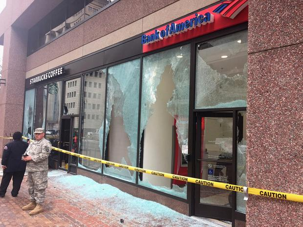 Tape closes off broken windows at businesses in Northwest Washington, Friday, Jan. 20, 2017, after a confrontation with protestors blocks from Donald Trump's inauguration. (AP Photo/Michael Biesecker)