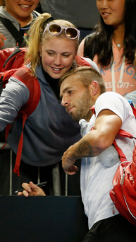 Marching on: Dan Evans is through to the last 16 of the Australian Open