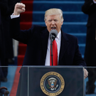 Donald Trump punches the air at his inauguration