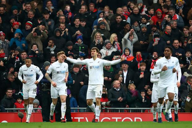 Fernando Llorente of Swansea City celebrates scoring his sides second goal during the Premier League match between Liverpool and Swansea City at Anfield on January 21, 2017 in Liverpool, England. (Photo by Julian Finney/Getty Images)