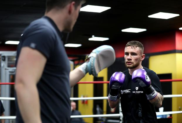 Trainer Shane McGuigan does some pads work in the ring with Carl Frampton during training today in a Las Vegas gym ahead of next Saturdays WBA featherweight title rematch against Leo Santa Cruz at the MGM Grand Hotel and Casino,Las Vegas. Press Eye - Belfast - Northern Ireland - 21st January 2017 - Photo by William Cherry