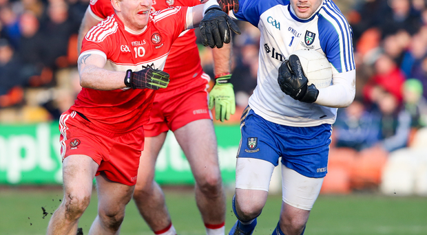 Close contact: Derry's Enda Lynn pursues Monaghan's Conor Forde