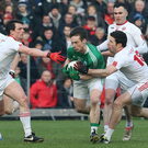 Hands off: Fermanagh ace Tomas Corrigan has unwanted attention from Tyrone duo Aidan McCrory and Sean Cavanagh