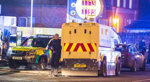 Police officers rush to the scene after an officer is shot on the Crumlin Road on 22nd January 2017 (Photo - Kevin Scott / Belfast Telegraph)