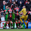 Flashpoint: Craig McClean intervenes as players surround the injured Ryan Catney