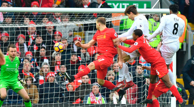 High flyer: Fernando Llorente heads his and Swansea's second goal of the afternoon
