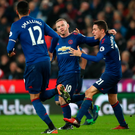 History man: Wayne Rooney breaks Sir Bobby Charlton's all-time scoring record for United