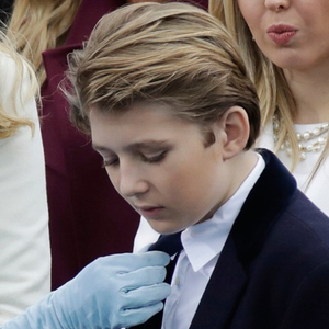President-elect Donald Trump's wife Melania Trump adjusts Barron Trump's tie before the 58th Presidential Inauguration for President-elect Donald Trump at the U.S. Capitol in Washington, Friday, Jan. 20, 2017. (AP Photo/Patrick Semansky)