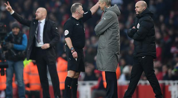 Verbal volley: Referee Jonathan Moss orders Arsene Wenger to leave the touchline against Burnley
