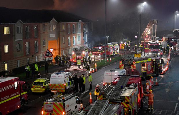 Emergency services at the scene of an explosion at the Bridge Point building in Hornchurch in east London. PA