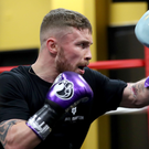 Powerful: Carl Frampton on the pads with trainer Shane McGuigan during training in Las Vegas