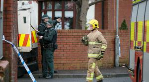 Police , ATO and Firefighters at the scene of a suspected explosion that took place inside a property in the Grosvenor Court area of west Belfast on 24th January 2017 (Photo - Kevin Scott / Belfast Telegraph)