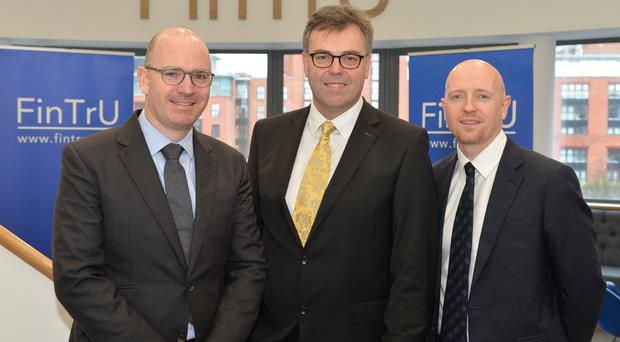 Darragh McCarthy, FinTru's chief executive, Invest NI chief executive Alastair Hamilton and Stephen Shaw, site head at FinTru's Belfast office