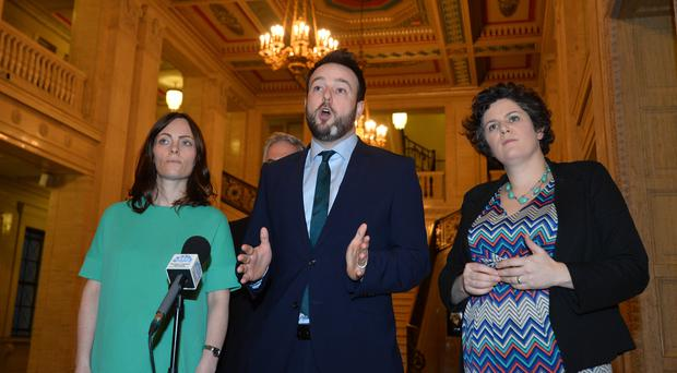 SDLP leader Colum Eastwood with MLAs Nichola Mallon (left) and Claire Hanna yesterday