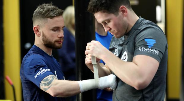 That's a wrap: Trainer Shane McGuigan wraps the hands of Carl Frampton