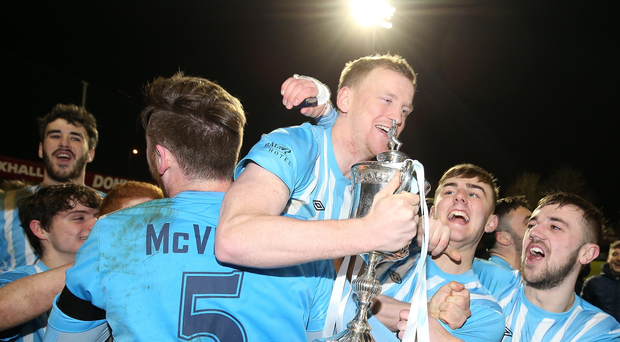 Up for the cup: Warrenpoint players celebrate after winning the Mid-Ulster Cup for the first time following a thrilling finish