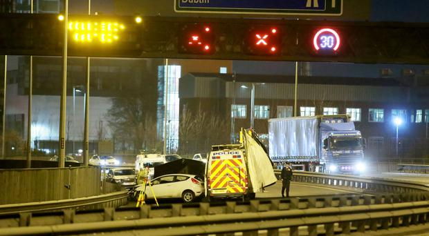 Police officers at the scene of a RTC on the Westlink close to the Broadway off slip on 25th January 2017 (Photo - Kevin Scott / Belfast Telegraph)