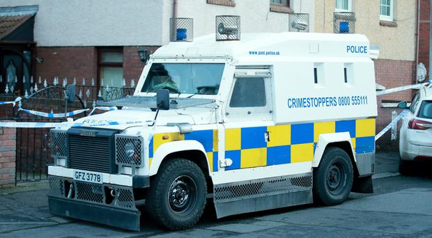 Police officers at the scene of the gun find. (Photo - Kevin Scott / Belfast Telegraph)