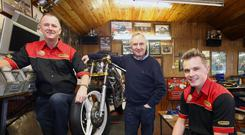 Home team: Simon Reid at home with dad Brian (centre) and sponsor Adrian Fegan from Crossan Motorcycles