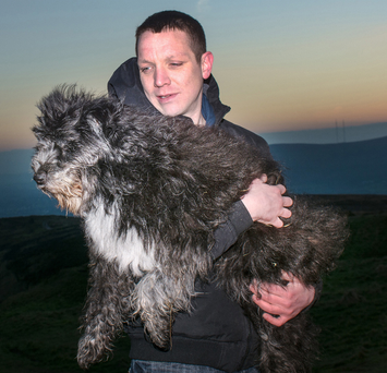 Carrickfergus man Dave Wright and his dog George at the Cavehill