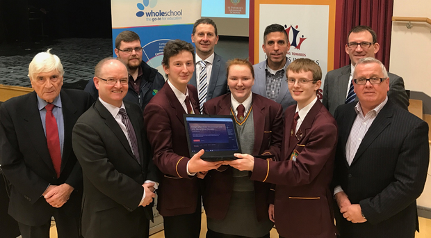 Celebrating the initiative are (back row, from left) councillors Dermot Curran and John Trainor; Sean Sloan of St Patrick's Grammar School; Kurt Walker of Pluralsight, and CCEA chief executive Justin Edwards, and (front, from left) Frank McGonagle, chief executive Wholeschool Software; head boy Michael McCusker; pupils Sian Owen and Frasier Hickland, and Colin Reid, past pupil and former chief executive of Totalmobile.