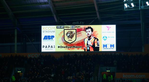 The electronic scoreboard displays a message of support for injured Hull City player Ryan Mason during the EFL Cup Semi-Final second leg match between Hull City and Manchester United at KCOM Stadium. (Photo by Alex Livesey/Getty Images)