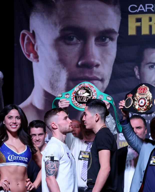 Press Eye - Belfast - Northern Ireland - 27th January 2017 - Photo by William Cherry Carl Frampton and Leo Santa Cruz face each other during Fridays weigh-in at the MGM Garden Arena, Las Vegas ahead of Saturdays rematch for the WBA featherweight title. Photo William Cherry/Presseye