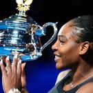 Serena Williams of the US holds the winner's trophy following her victory over Venus Williams of the US in the women's singles final on day 13 of the Australian Open tennis tournament in Melbourne. PA Pic