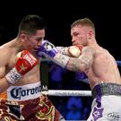 Press Eye - Belfast - Northern Ireland - 28th January 2017 - Photo by William Cherry Carl Frampton in the ring with Leo Santa Cruz as they fight for the WBA featherweight title at the MGM Garden Arena, Las Vegas Photo William Cherry/Presseye