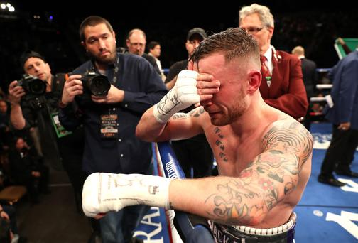 Carl Frampton is dejected after losing his WBA featherweight title to Leo Santa Cruz at the MGM Garden Arena, Las Vegas. Photo William Cherry/Presseye