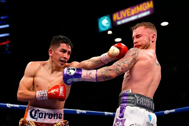 LAS VEGAS, NV - JANUARY 28: Leo Santa Cruz (L) lands a punch on Carl Frampton during their WBA featherweight title fight at MGM Grand Garden Arena on January 28, 2017 in Las Vegas, Nevada. Cruz took Frampton's title with a majority decision win. (Photo by Steve Marcus/Getty Images)