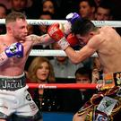 LAS VEGAS, NV - JANUARY 28: Carl Frampton (L) throws a left at Leo Santa Cruz in the 11th round of their WBA featherweight title fight at MGM Grand Garden Arena on January 28, 2017 in Las Vegas, Nevada. Cruz won by majority decision. (Photo by Ethan Miller/Getty Images)