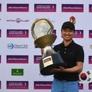 Young winner: Jeunghun Wang with the trophy after the final round of the Commercial Bank Qatar Masters