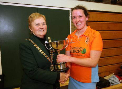 Silver lining: Ivy Dennis, president of Hockey Ireland, presents the Indoor trophy to Ards captain Caroline Adams