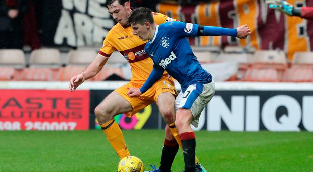 Jostle: Emerson Hyndman battles with Ben Heneghan