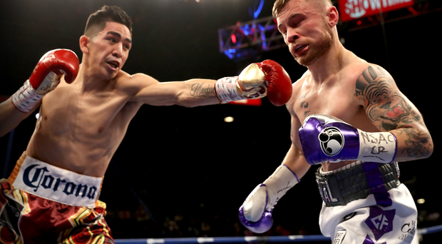 Prize fighter: Leo Santa Cruz connects with Carl Frampton during the World title clash in Las Vegas