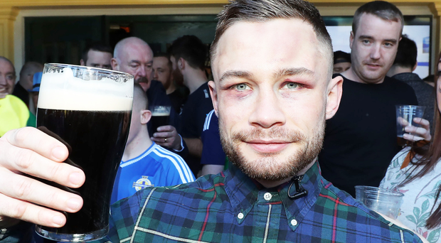 Carl Frampton downs a pint of stout in the company of hundreds of fans at the Nine Fine Irishmen bar in Las Vegas last night