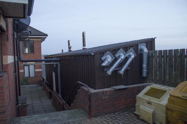 Woodvale and Shankill housing association wood burning boilers.