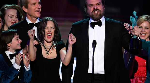 Winona Ryder and David Harbour of 'Stranger Things' accept the Outstanding Performance by an Ensemble in a Drama Series onstage during The 23rd Annual Screen Actors Guild Awards at The Shrine Auditorium on January 29, 2017 in Los Angeles, California. (Photo by Kevin Winter/Getty Images )