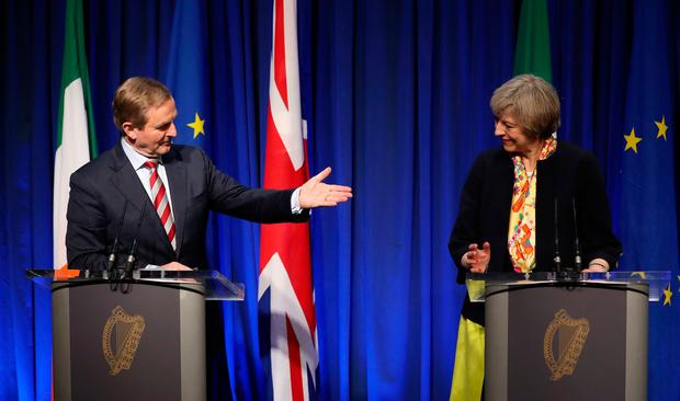 Taoiseach Enda Kenny TD and Prime Minister Theresa May during a press conference at Government Buildings in Dublin. Niall Carson/PA Wire