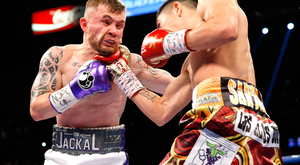 Painful: Carl Frampton takes a right from Leo Santa Cruz in Las Vegas at the weekend