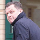 Former footballer Jim Magilton arrives at Antrim Magistrates Court