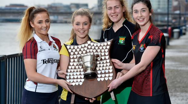 Head girls: (from left) captains Hannah Irwin (RS Armagh), Jayne Kilpatrick (Wallace High), Amy Rothwell (Sullivan) and Orla Thompson (Banbridge Academy) at yesterday's Belfast Telegraph Schools' Cup semi-final draw