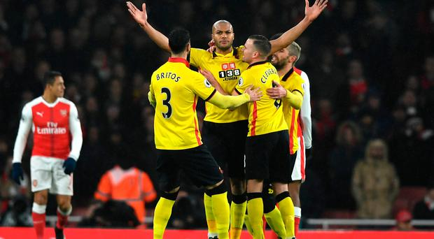 Watford's Younes Kaboul celebrates scoring the opening goal with his team-mates